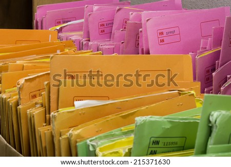patient files in medical office - stock photo