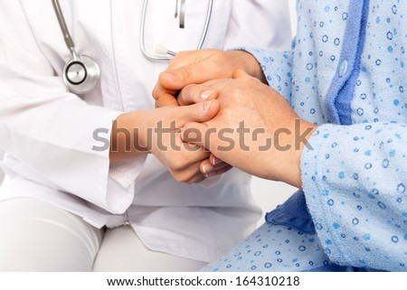 Patient hand holding - stock photo