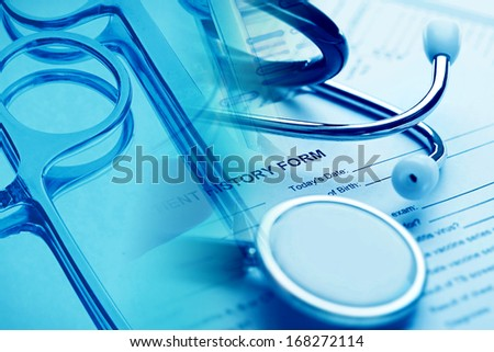Patient history form, stethoscope and laboratory tools. Medical concept. - stock photo