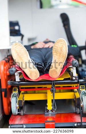 Patient in ambulance medical paramedic's truck - stock photo