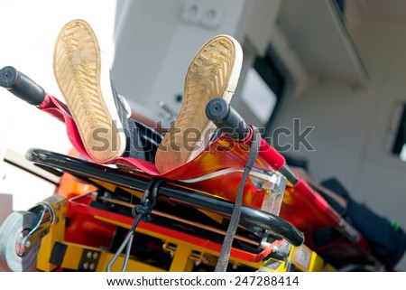Patient in emergency car ambulance medical chart  - stock photo