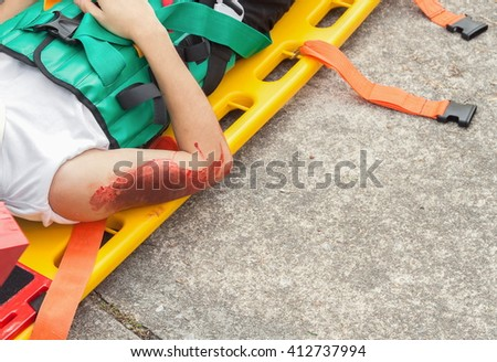 patient Injury upper arm,Wait physician assist patient in emergency rescue situations, stretcher for people with neck or back injuries, example medical equipment transport. (accident victim) - stock photo
