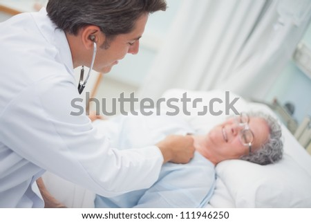 Patient is auscultating with a doctor in hospital ward - stock photo