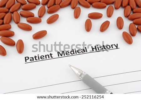patient medical history document with pills and pen - stock photo