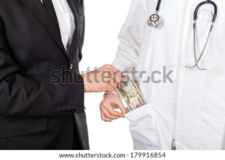 Patient paying for medical services with dollar - stock photo