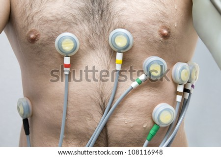Patient performing an EKG at the clinic - stock photo