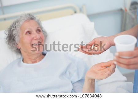 Patient receiving drugs in hospital ward - stock photo