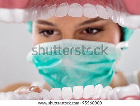 Patient's mouth being inspected by dentist - stock photo