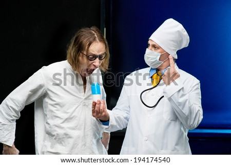 Patient takes the pill out of the hands of the doctor - stock photo