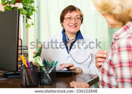 Patient talking with a friendly woman doctor with stethoscope
