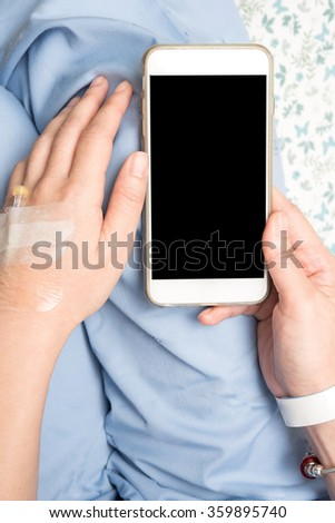 patient using smart phone in hospital - stock photo