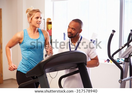 Patient Using Treadmill In Hospital Physiotherapy Department - stock photo