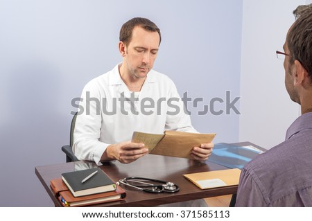 Patient while talking with a doctor about the test results / radiography