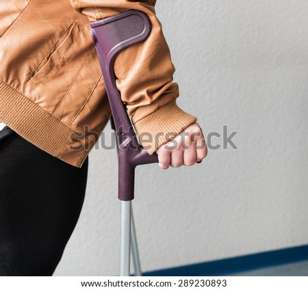 Patient with crutches in hospital