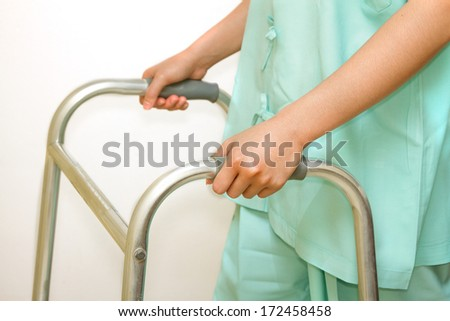patient woman using a walker,walking aid for training - stock photo