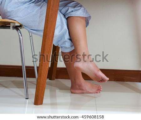 Patient women that cross-legged sit in a chair. - stock photo