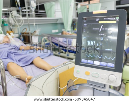 Patients crisis Lying in bed EKG machine Blood pressure heart,Emergency patients in Hospital ,blur