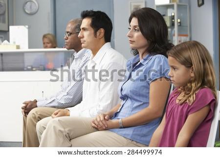Patients In Doctors Waiting Room - stock photo
