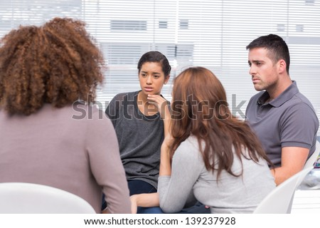 Patients listening to another patient during therapy session - stock photo