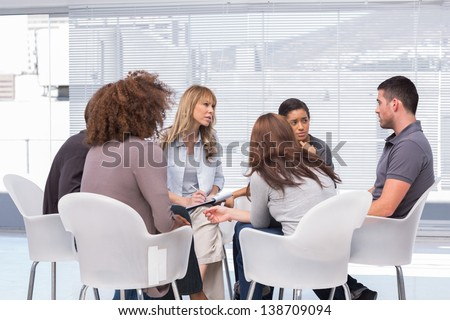 Patients telling their problems to therapist during session - stock photo