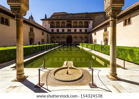 Patio de los Arrayanes (Court of the Myrtles) in La Alhambra, Granada, Spain. - stock photo