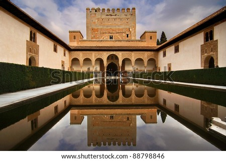 Patio de los Arrayanes (Court of the Myrtles) in La Alhambra, Granada, Spain. The Torre de Comares (Comares tower) is reflected in the pond. - stock photo