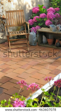 patio flowered with terracotta tiles