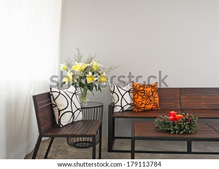 Patio lounge with garden bench and advent wreath flower decoration - stock photo