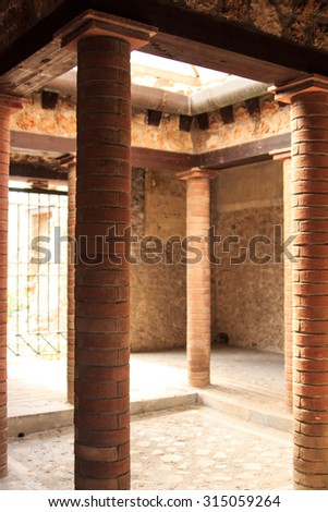 Patio of a Villa in Pompeii, Italy. Pompeii is an ancient Roman city died from the eruption of Mount Vesuvius in the 1st century. - stock photo