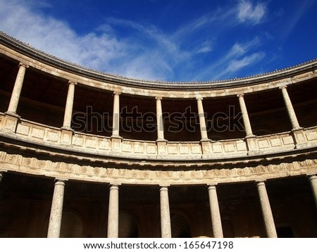 Patio of Charles V Palace with La Alhambra in Granada, Spain - stock photo