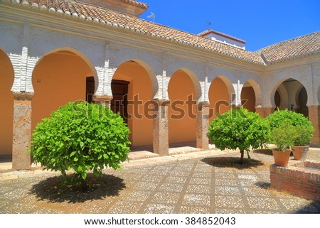 Patio of San Salvador church with small green trees, Granada, Andalusia, Spain