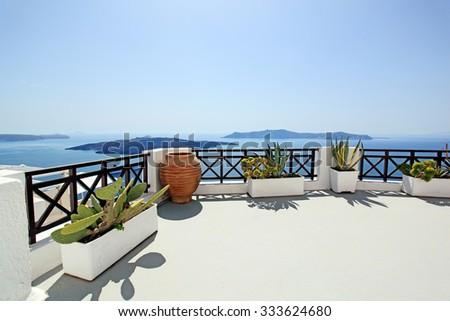 Patio overlooking Aegean Sea, Fira Town, Santorini Island, Greece - stock photo