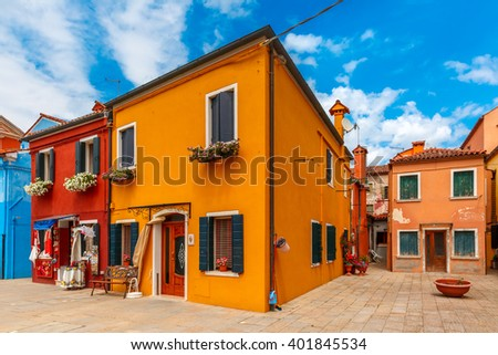 Patio with colorful houses on the famous island Burano, Venice, Italy - stock photo