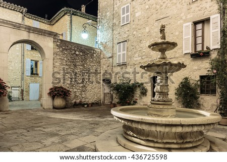 Patio with fountain in the old village Tourrettes-sur-Loup at night, France. - stock photo