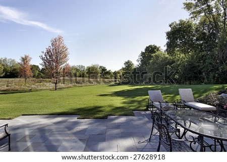 Patio with yard and forest - stock photo