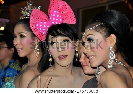 PATONG,PHUKET ISLAND, THAILAND - JAN 2, 2011:  Three of the legendary Simon Cabaret lady boys posing outside the theatre following a performance - stock photo