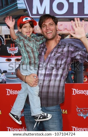 "Patricio Borghetti and son at the Grand Opening of ""Cars Land,"" Disney California Adventure, Anaheim, CA 06-13-12"