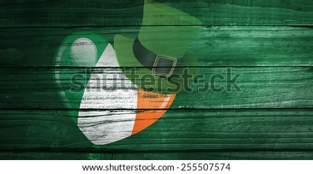 patricks day graphics against overhead of wooden planks - stock photo