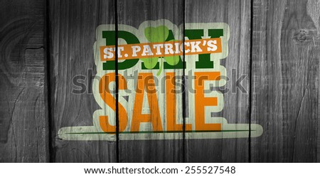 patricks day sale ad against overhead of wooden planks - stock photo