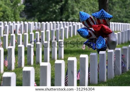 Patriotic balloons at the Arlington National Cemetery in Arlington, Virginia, near Washington DC, on Memorial Day - stock photo