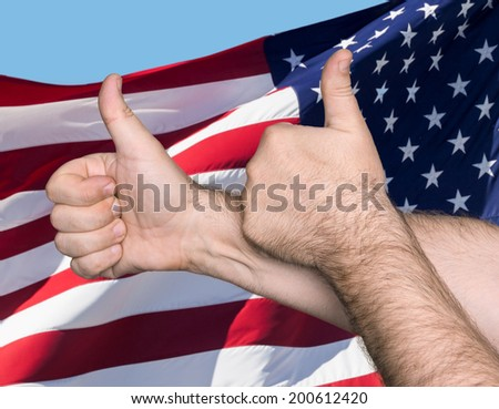 Patriotic concept. Thumbs up sign against of United States of America flag