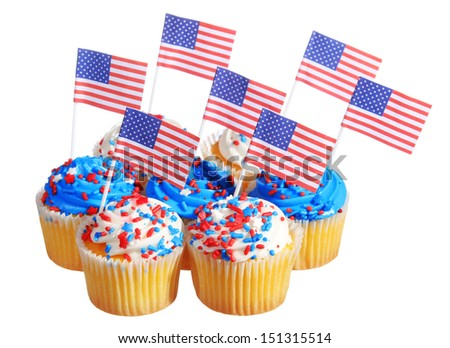 Patriotic cupcakes decorated with American Flags and blue, white cream with red stars sprinkles on the top, isolated on white background. - stock photo