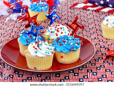 Patriotic cupcakes in a festive celebratory table setting.  Great for July 4th, Memorial Day or Veterans Day.