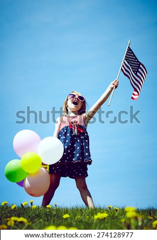 Patriotic holiday child with American flag and balloons for july 4th.