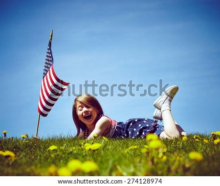Patriotic holiday child with American flag for july 4th.