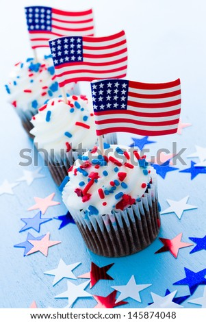 Patriotic holiday cupcakes decorated for july 4th. - stock photo