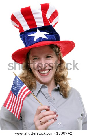 Patriotic lady waving a small American Flag and wearing a patriotic hat isolated against a white background.
