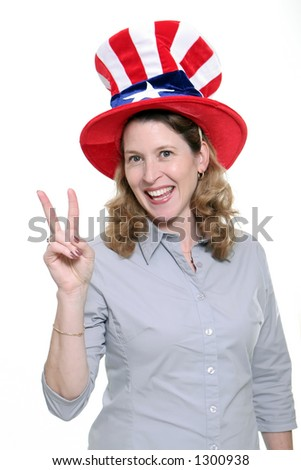 Patriotic woman showing the peace symbol isolated against a white background.