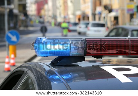 patrol car police patrol in the city before the arrival of the authorities - stock photo