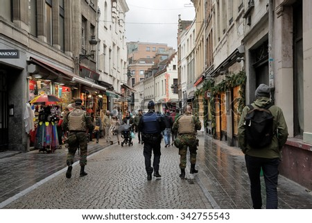 Patrol on Rue de l'Etuve in center of Brussels, Belgium on 20 November, 2015. Soldiers and police patrol streets together.